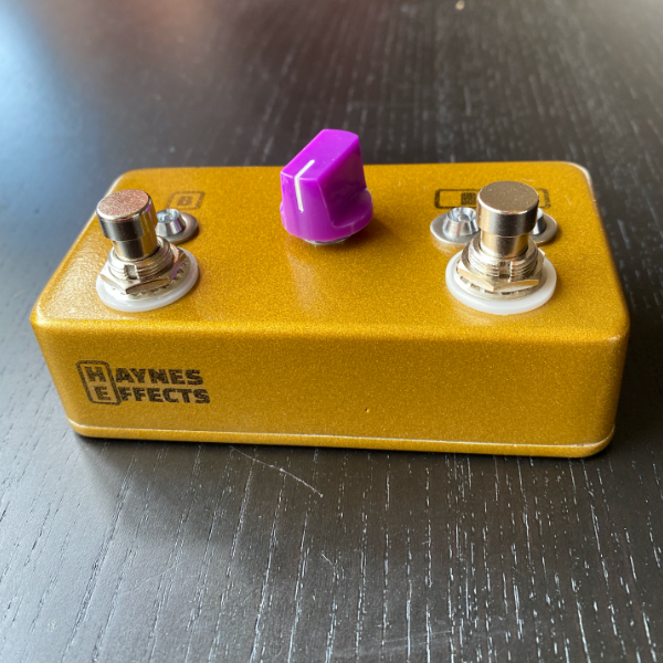 The Haynes Effects positional boost pedal from the front, showing the logo and footswitches
